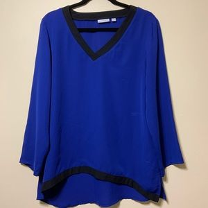Large bluish purple top with black v neck